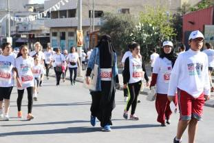 A Palestinian lady proves her right to run with 'niqab' showing a peaceful image of Muslims who have been presented lately as terrors in the world. Photo by Bethlehem Bible College-Amira Farhoud