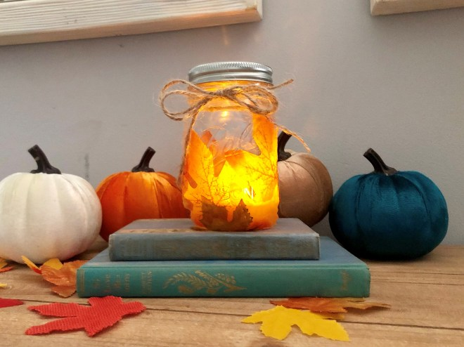 LED mason jars with tea lights and covered with fall leaves will leave a beautiful illuminance in you entry way