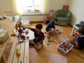 While the girl's made ponies the boys played with lego.