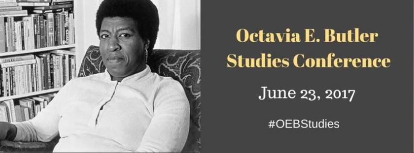 "Promotional image for the conference. On the left is a black and white image of Octavia E. Butler. She is a black woman wearing a long sleeved light shirt, looking directly into the camera without smiling. She has a short afro and is sitting in a fabric patterned chair with a bookcase visible to the left behind her. On the right side of the image are the words ""Octavia E. Butler Studies Conference"" in light orange and ""June 23, 2017"" ""#OEBStudies"" in white against a gray background"
