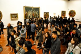 Crowd viewing Botticelli's masterpiece