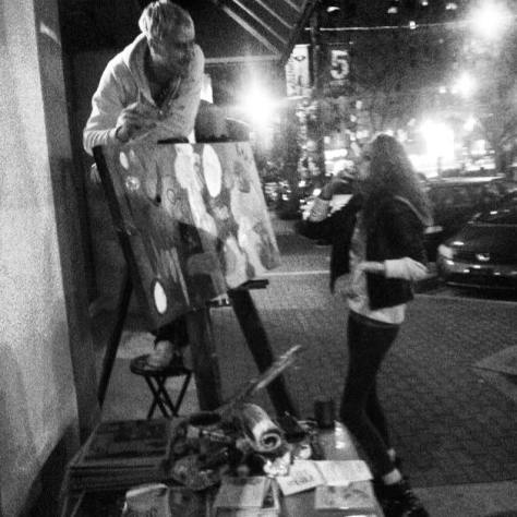 The night after the theft, I was back outside Rain Dogs, painting and selling prints. 'Cause I'm not gonna let some asshole fuck me up and slow me down. My buddy Steph took this photo of me and Wallis out front.