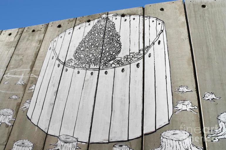a-banksy-graffiti-on-the-separation-wall-in-palestine-stefano-baldini