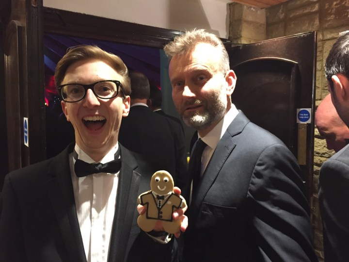 Sam French of Sam's Kitchen with gingerbread man and Hugh Dennis at Gatwick Diamond Business Awards