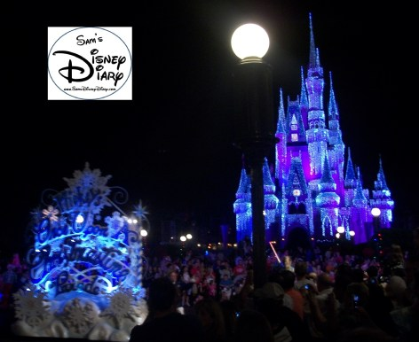 Mickey's Once Upon a Christmastime parade passes by the Holiday Lights on Cinderella's Castle.