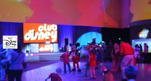 Mickey and other characters dance with guests at Club Disney