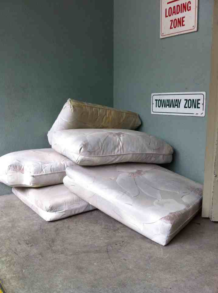 Mattress, boxspring, couch, desk, sofa bed, some yard waste, green waste, table, kitchen cabinet Removal | Vancouver