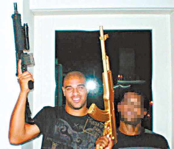 Adriano toting guns with members of Red Command, a Rio de Janeiro crime outfit.