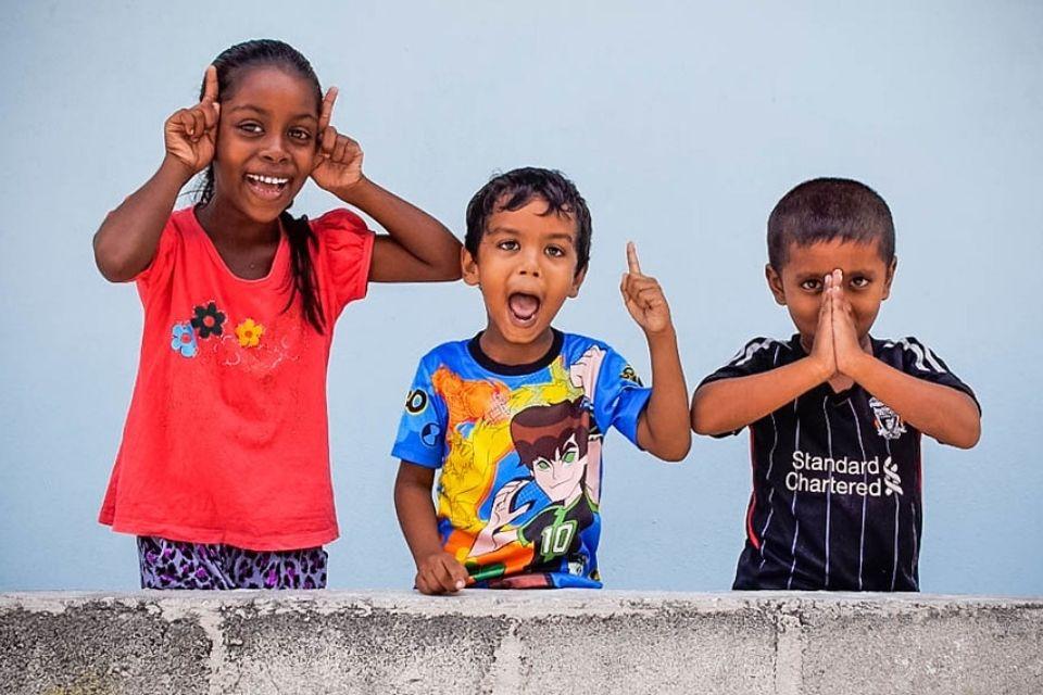 Kids cheering on Huraa Island - Full Day Maldives Adventure Trip