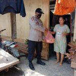 Polisi Aceh Berikan Bantuan Sembako Kepada Warga Terdampak Covid-19