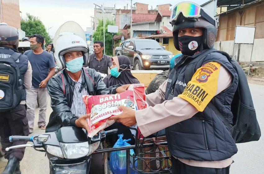 Kegigihan Kapolres Lhokseumawe Dalam Menyalurkan Sembako Kepada Masyarakat