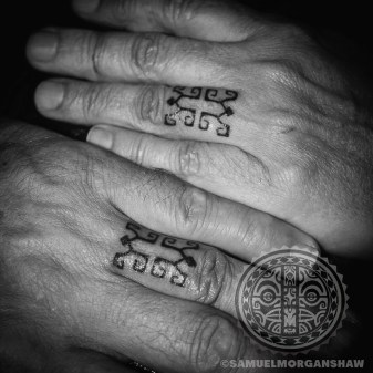 Marquesas style finger tattoos