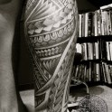 A fun freehand Samoan style leg tattoo