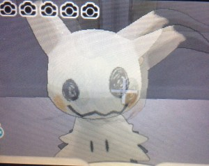 Turn around and you will be up close with The Totem Pokemon Mimikyu! Take a snapshot to encounter it!