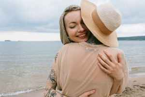 photo of women hugging each other