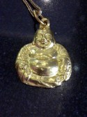 This is from my personal collection. I wear this pendant everyday. In choosing an image of the Happy Fat Buddha to be worn as a pendant, always look for the face. Make sure that it has happy jolly face.