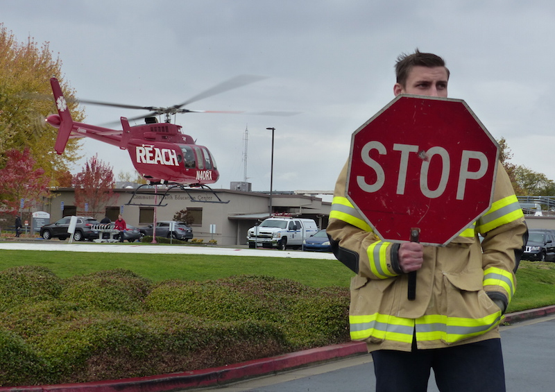 Firefighters secure the helicopter landing zone at Mark Twain Medical Center