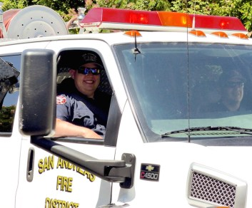 Firefighter Keifer Minehart, recently back from a strike team assignment, smiles from the cab of engine 163.