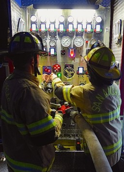 Working the control panel of Engine 165.