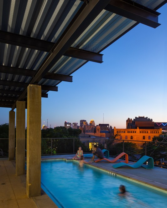 Common areas, including the pool, gym and rooftop terrace help create community.