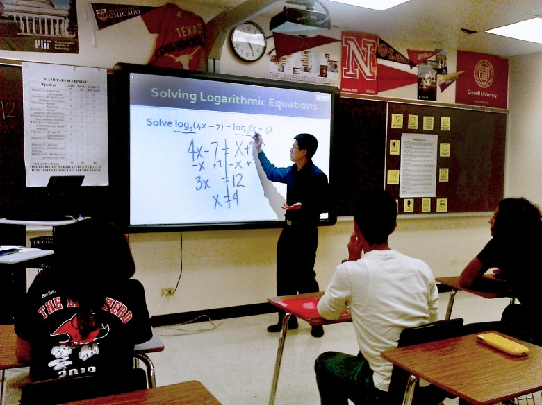Chan solves a logarithm equation for his algebra students.