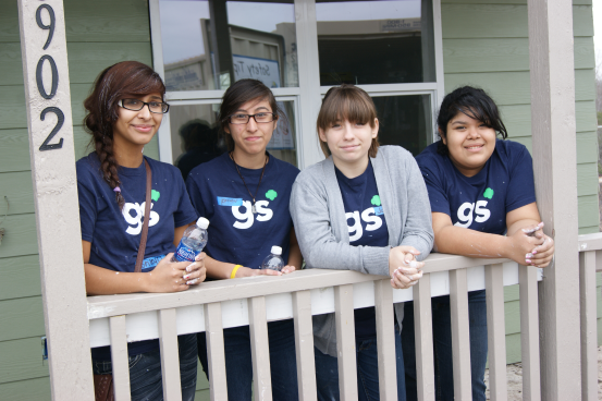Gamma Sigma Girls from San Antonio Independent School District taking a water break during a Take Action project benefitting Habitat for Humanity.
