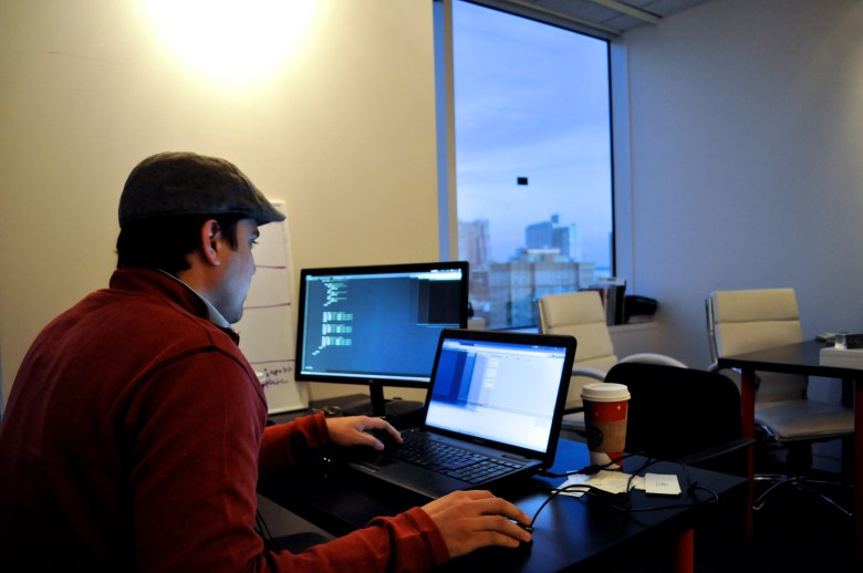 Spencer Cooley, freelance web developer. Photo by Iris Dimmick.