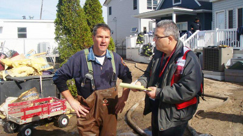 Firefighter Joseph Aminolfi (left) being interviewed by Steve Brown in Breezy Point, N.Y. Photo courtesy of The Red Cross.