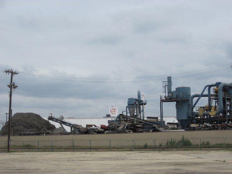 The Newell Plant, where cars go to die in the shadow of the abandoned Lone Star brewery. Photo by Jens Rushing.