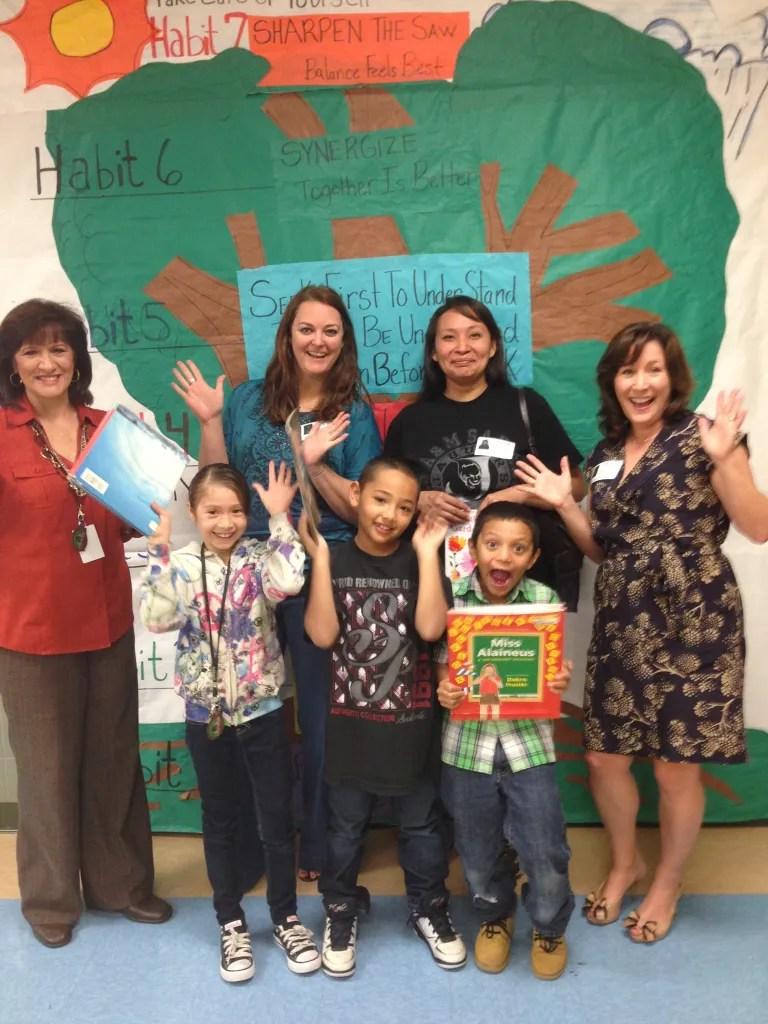 (l to r) Nita Salisbury, Ariana Gomez, Ms. Duncan, Trent, Theresa Arellano, Salvador, and Leslie Komet Ausburn celebrate reading.
