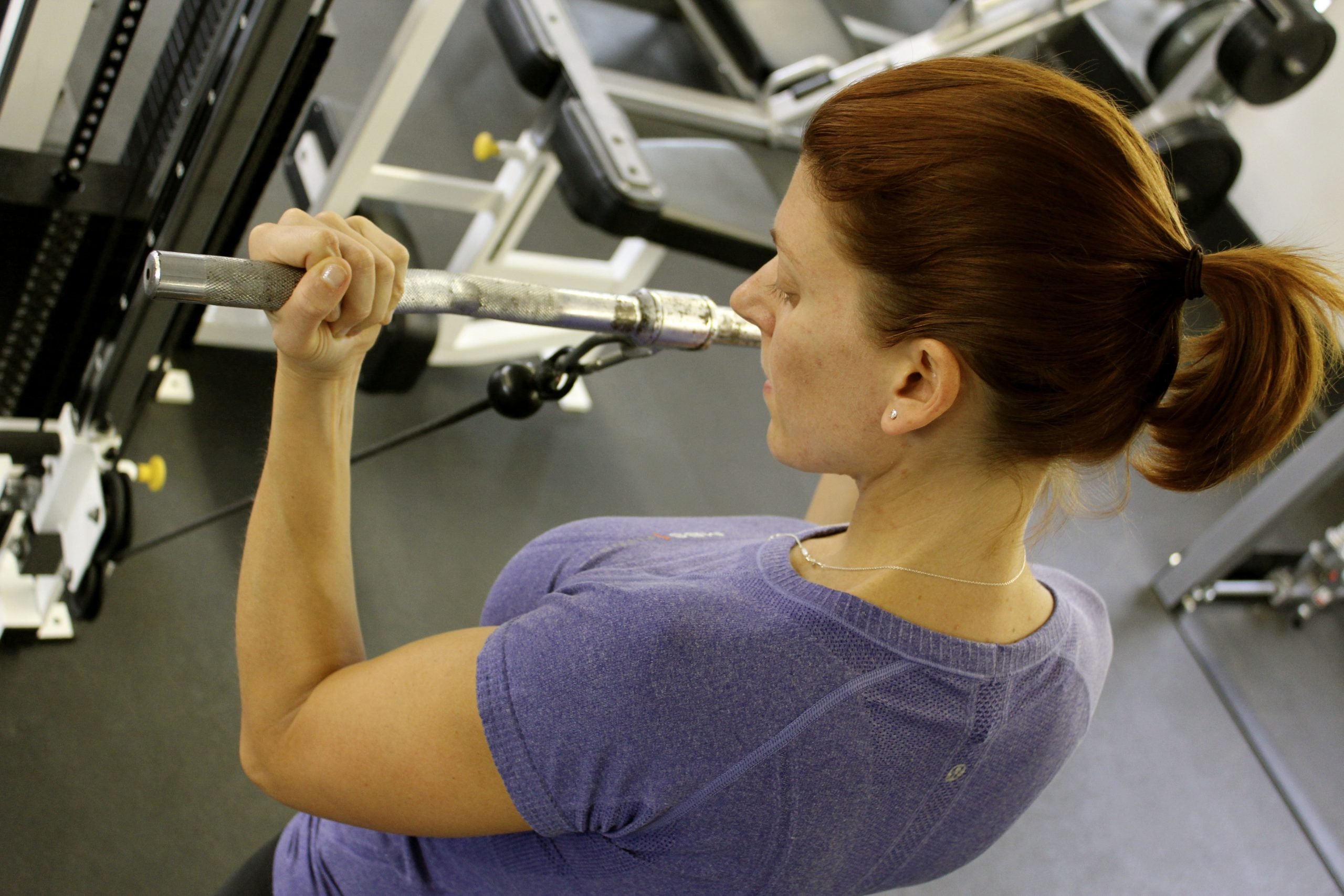 Amanda Avey works out at the gym. Strong arms. Photo by Tom Trevino.