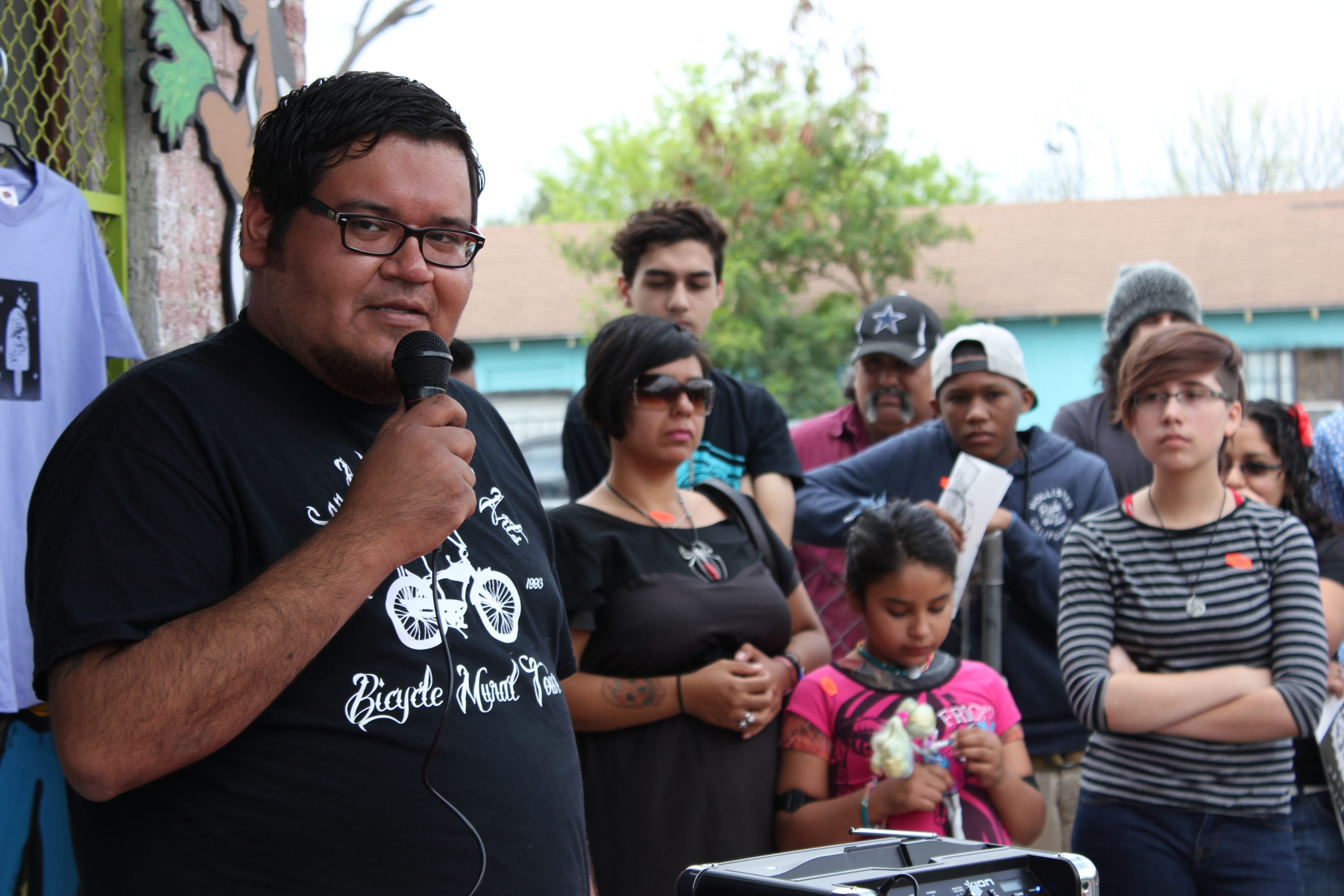 The anticipation. John Medina speaks on the paleta making process at the bike rack unveiling ceremony at San Anto Cultural Arts. Photo by Melanie Robinson.