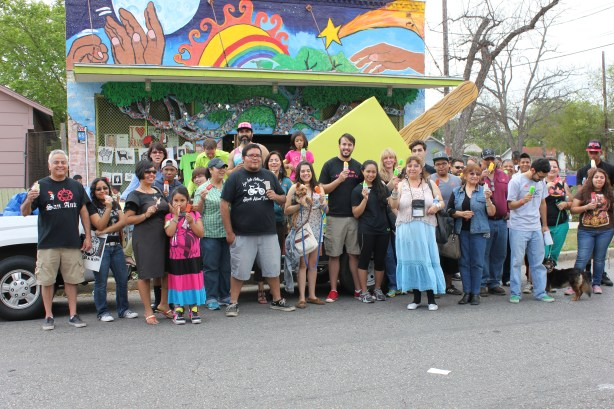 San Anto Cultural Arts organizers and community members gather for a group photo in front of their new paleta bike rack. Photo by Melanie Robinson.