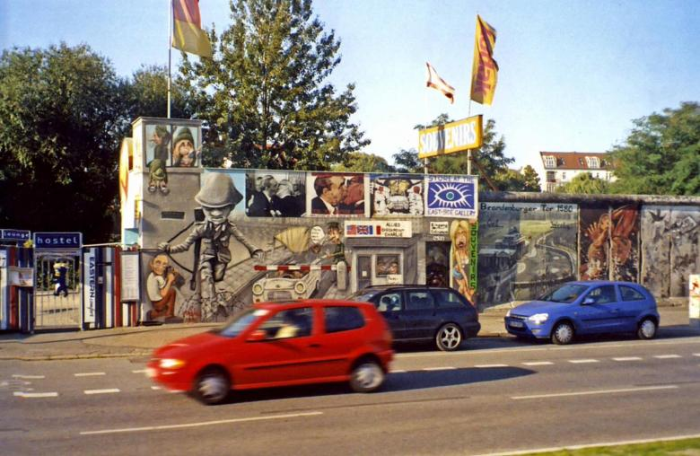 A preserved portion of the Berlin Wall. The wall was begun in 1961 and completely encircled West Berlin. The beginning of the end of the wall came in 1989 when the East German regime allowed East Berliners to visit West Berlin. The former wall is marked in some places by cobblestones.. Photo via CIA World Factbook.