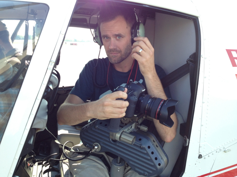 Adam Stielstra, creative director for the SARA's San Antonio River Documentary, prepares his camera and gear for take off in a rented helicopter. Photo courtesy of SARA.
