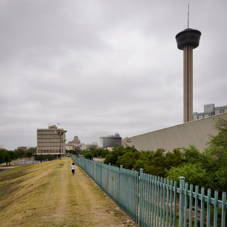 The act of walking along the summit of the earthen fortifications that surround the Institute of Texan Cultures is in fact a compelling urban experience