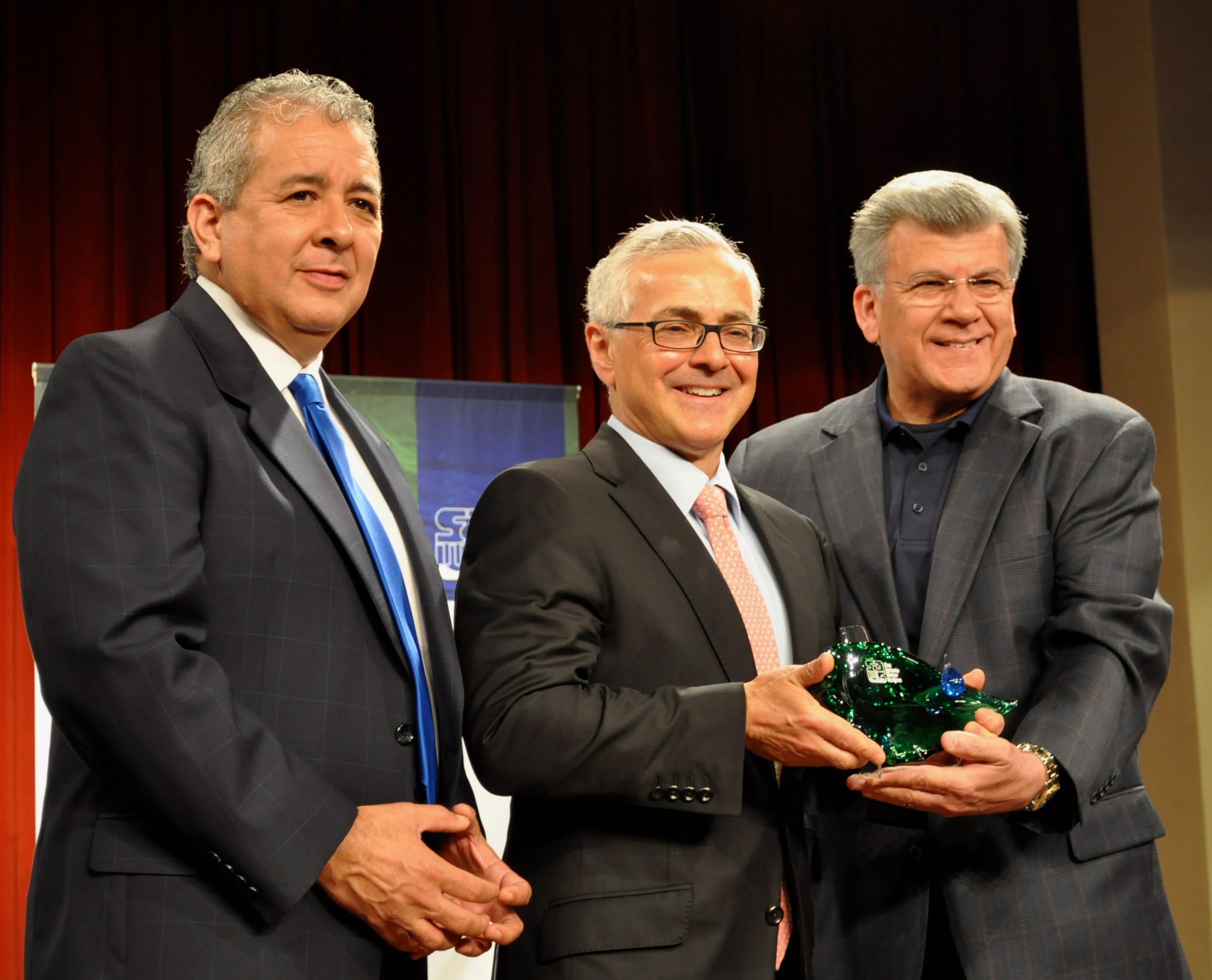 """John Badagliacco, general manager of The Shops at La Cantera, (center) accepts the 2013 SAWS Refreshing Ideas Award from and SAWS Chairman Heriberto """"Berto"""" Guerra (right) and SAWS President and CEO Robert Puente. Photo by Iris Dimmick."""
