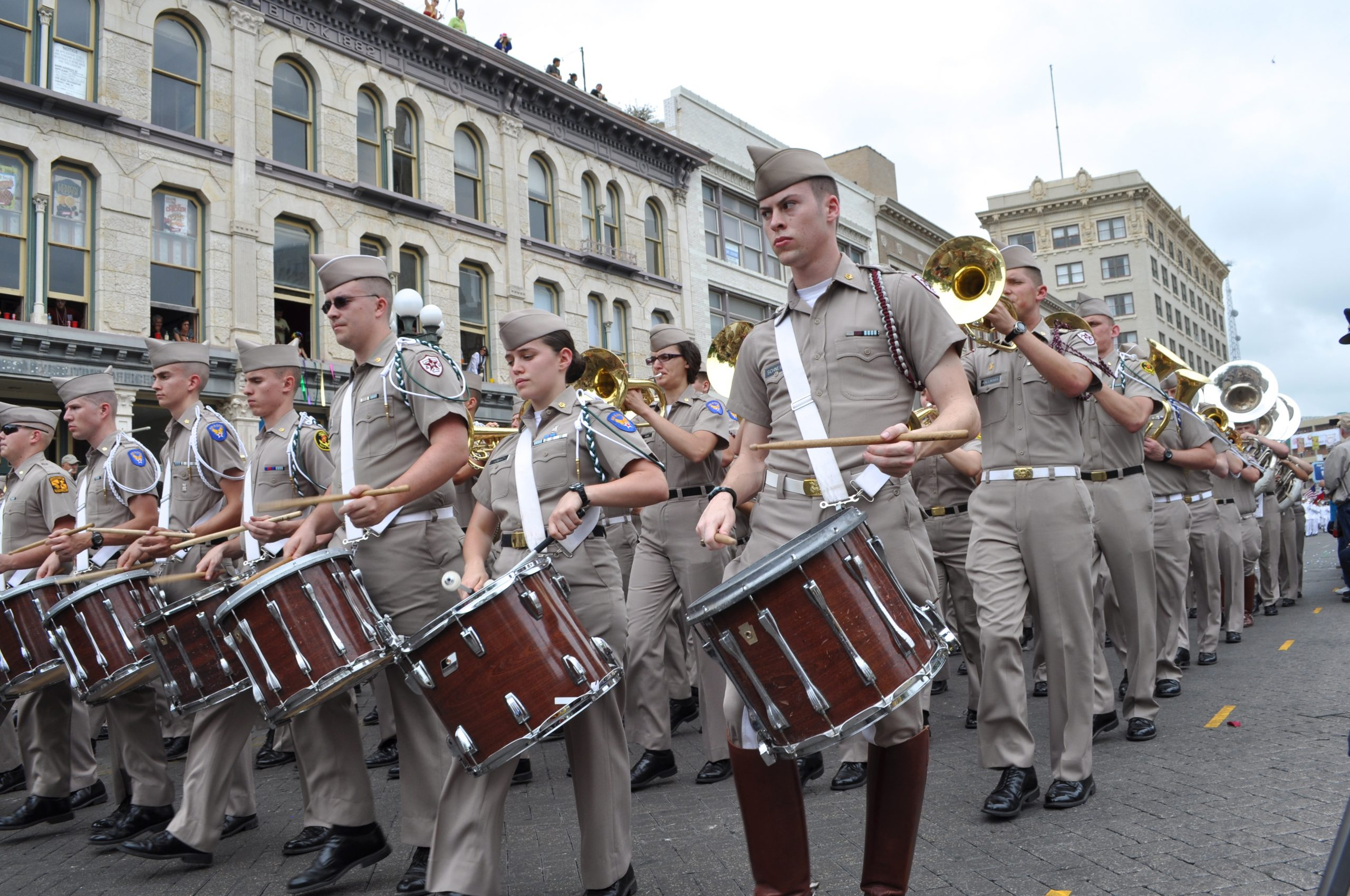 A marching band performs during the Battle of the Flowers Parade (2013). Photo by Iris Dimmick.