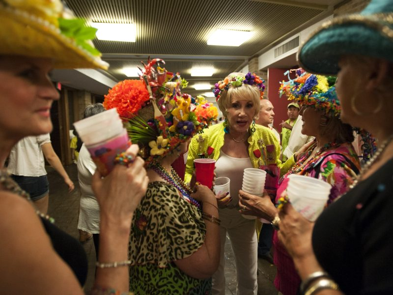 A croup of especially passionate Fiesta revelers convene over drinks and flowers. Photo by Corey Leamon.