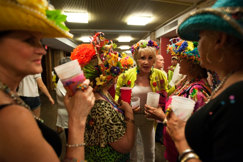 A group of especially passionate Fiesta revelers convene over drinks and flowers. Photo by Corey Leamon.