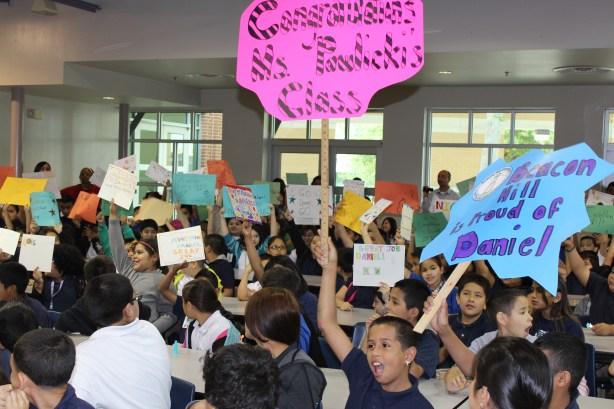 Daniel's Beacon Hill classmates cheer him along at a fundraising event. Photo courtesy of SAISD.