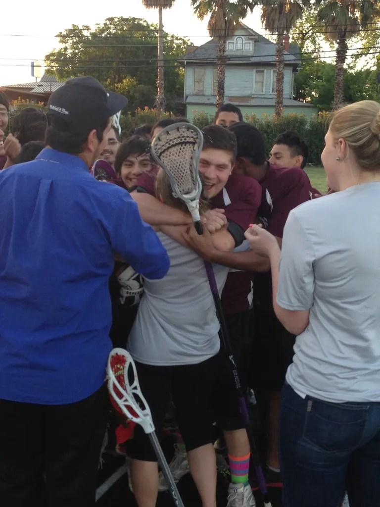 Team hug! Coach Mary Mattia and her team of smelly high school boys.