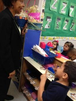 Kindergarten students show off their counting skills for Lamar Elementary Principal Sharon Robinson.