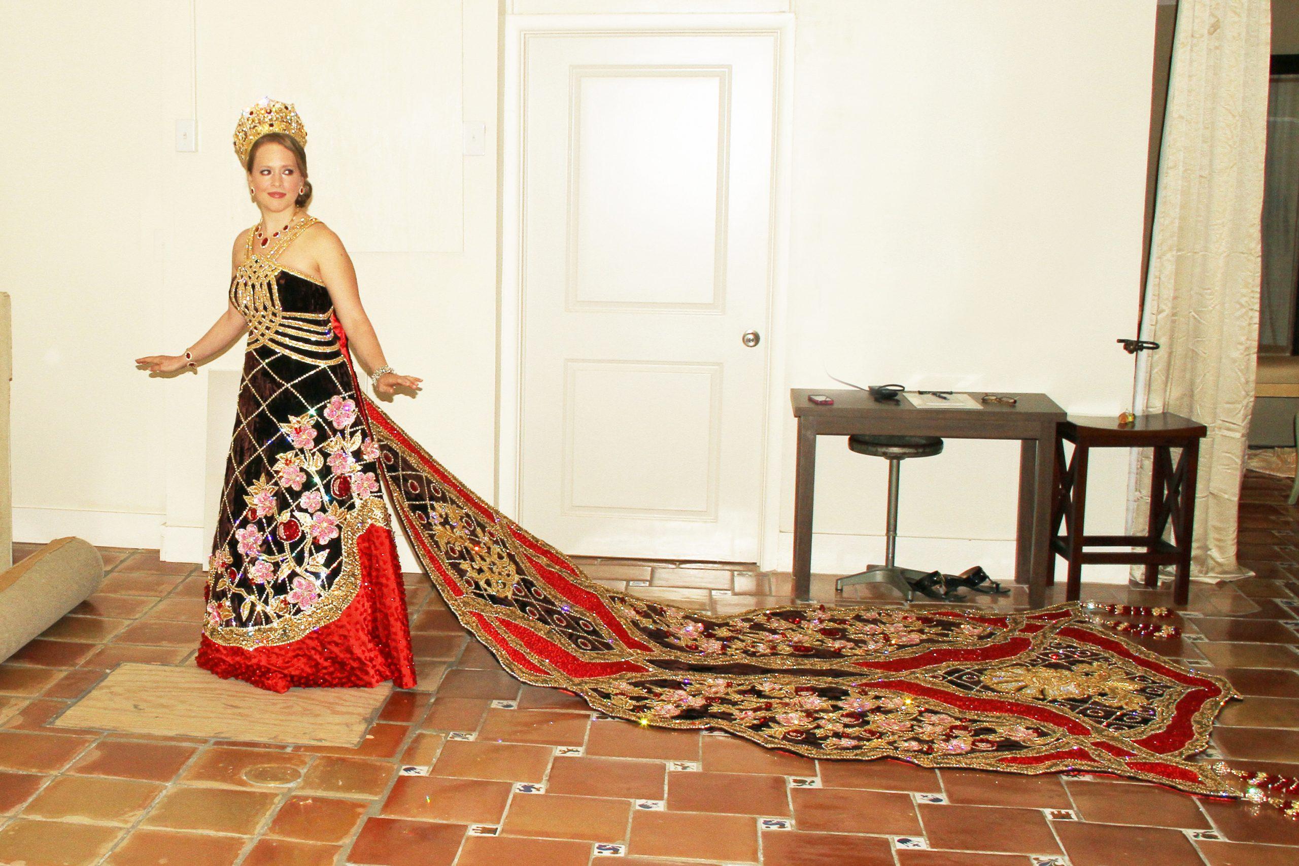 Jennifer practices walking in her elaborate coronation dress. Photo by Gary Stanko of Billo Smith Studios.