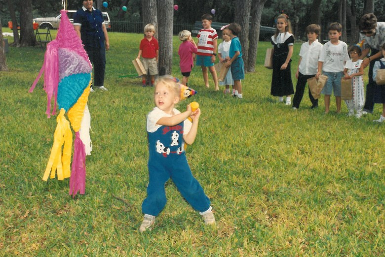 A young Jennifer Berg takes a swing at a piñata in celebration of her birthday at her family's home in Alamo Heights. Photo courtesy of Jennifer Berg.
