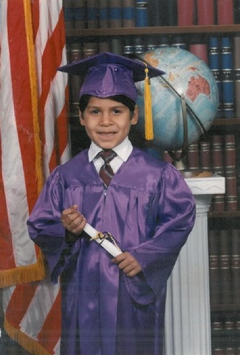 A newly bilingual Rey Saldaña graduates from South San kindergarten. Photo courtesy of Rey Saldaña