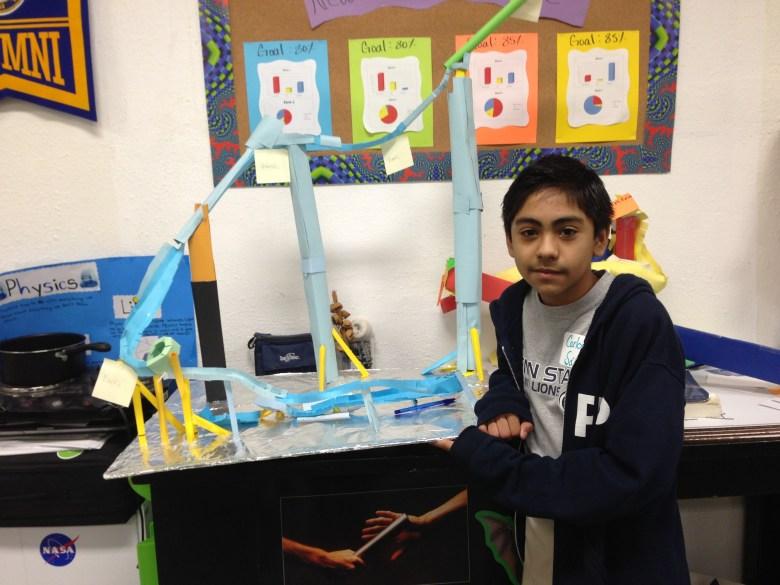 Carlos Sanchez shows off his physics roller coaster at KIPP Aspire.