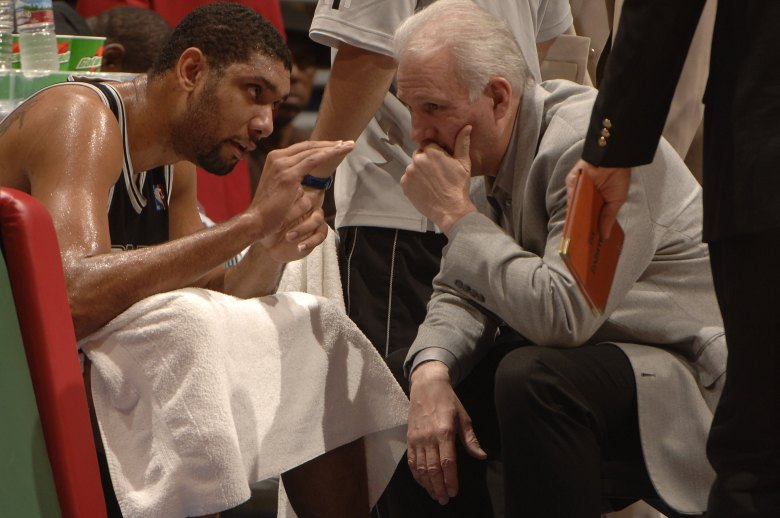 Time out: Tim Duncan and Spurs Head Coach Gregg Popovich confer during a game against the Los Angeles Clippers in 2006.  Photo courtesy of San Antonio Spurs (Getty).