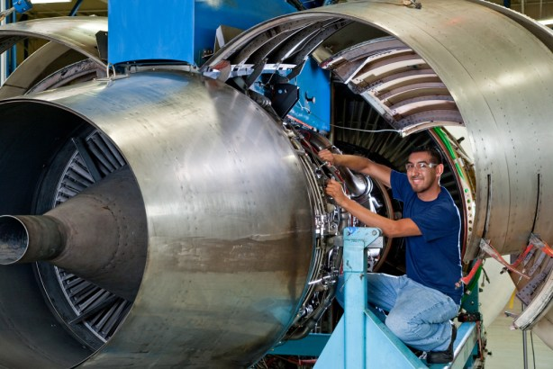 Adam Arroyo works on a Jet Engine. Photo courtesy of Alamo Colleges.