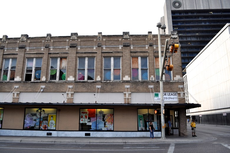 201 E. Commerce St. gets a make-over. Window and interior art and displays by artists Rex Hausmann and David Almaguer of Hausmann Millworks. Photo by Iris Dimmick.